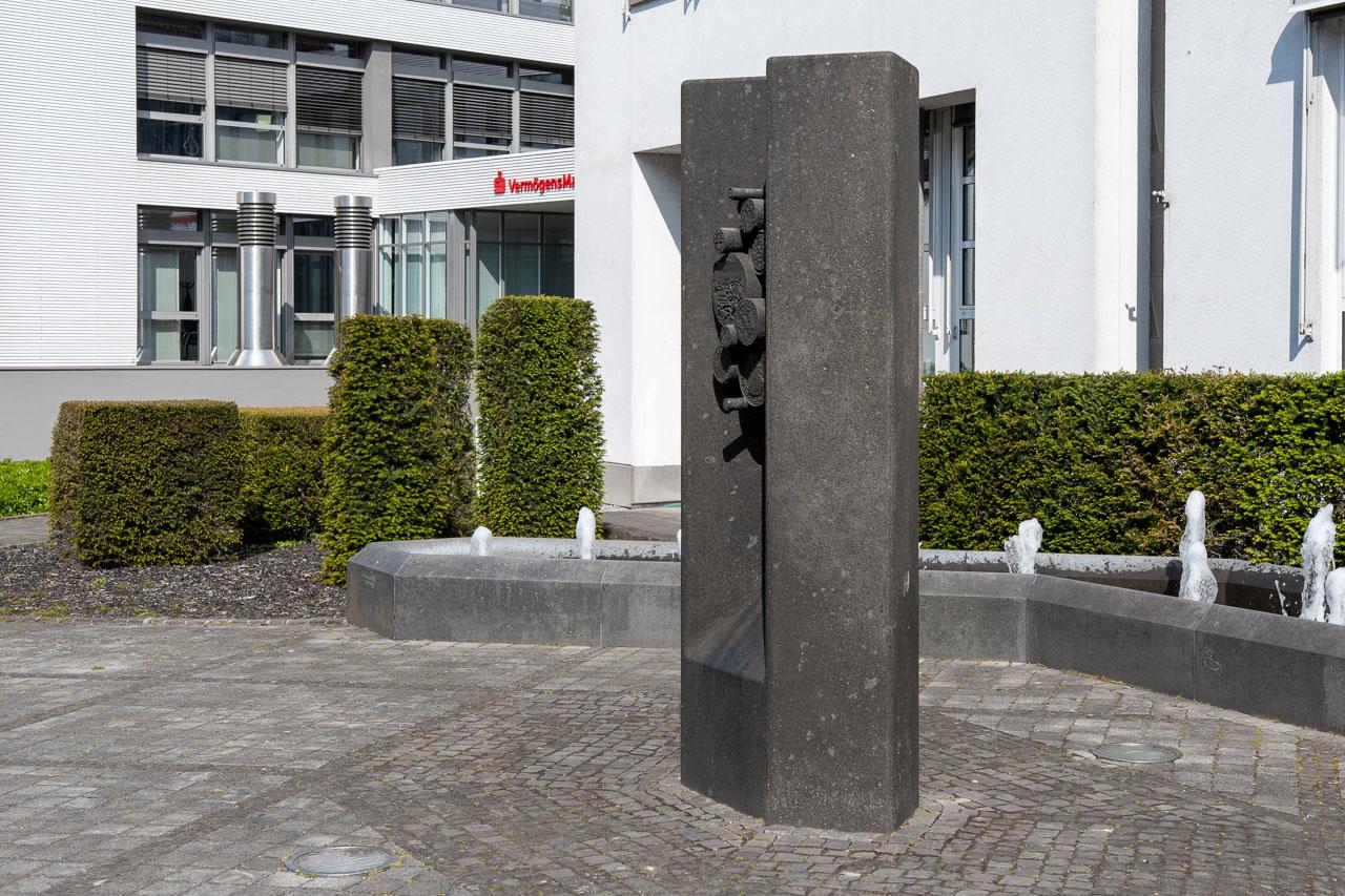 Brunnenanlage das Geld von Heinz Bergkemper